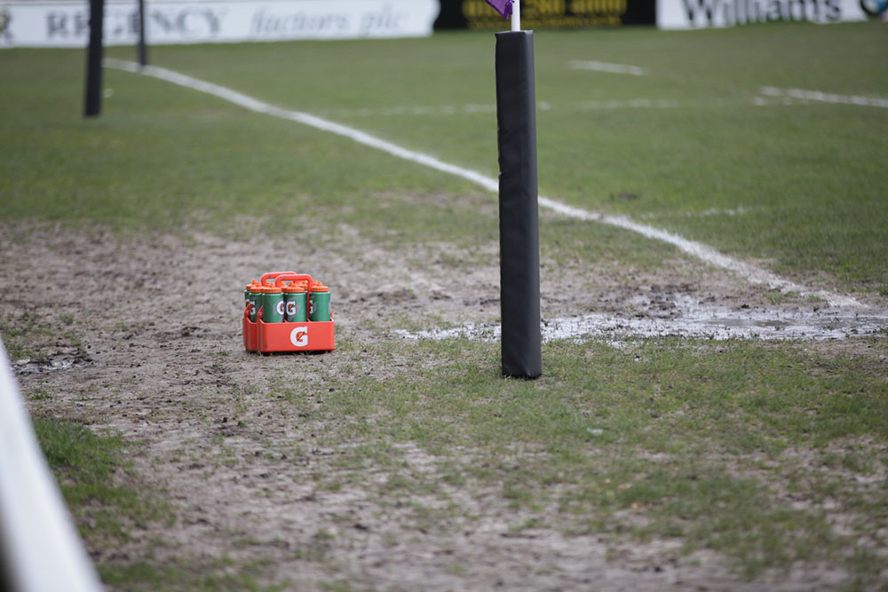 water bottles at the side of a sports pitch